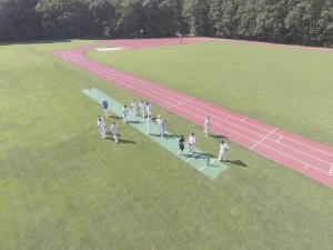 The players gsther on the drone landing strip
